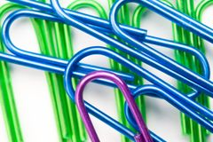 Blue, green, and purple paper clips Royalty Free Stock Photography