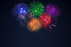 Blue green purple red yellow celebration fireworks Royalty Free Stock Photography