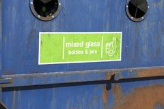 Blue and green recycle bin outdoors. Close up image of a blue and green recycle bin outdoors Royalty Free Stock Image