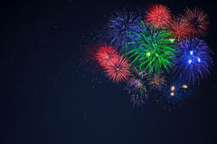 Blue green red fireworks located right side Royalty Free Stock Photos