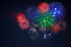Blue green red fireworks over starry sky Stock Photo