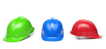 Blue, green, red hard hats Stock Photo
