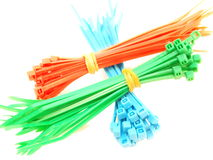 Blue, green and red plastic wire ties Stock Photos