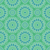 Blue and green repeating kaleidoscope mosaic pattern. Vector Stock Photo