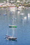 Blue and Green Sailboats in Bay Royalty Free Stock Photography