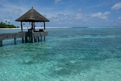 Wooden pavilion in the sea in Maldive island resort stock images