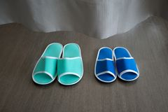 Blue and green slippers behind curtain in the hospital royalty free stock images
