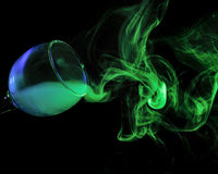 Blue and green smoke in a glass. Halloween. Royalty Free Stock Image