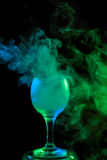 Blue and green smoke in a glass. Halloween. Royalty Free Stock Photography