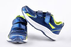 Blue and green sport trainers. Royalty Free Stock Photos