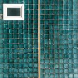 Pattern of many shade of color window squares. Blue-green stained-glass window with small squares background Royalty Free Stock Images