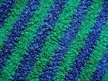 Blue and green striped terry cloth royalty free stock image