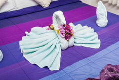 Blue Green Swans in Heart Shaped Towel Stock Image
