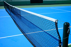 Blue and green tennis court Stock Photos