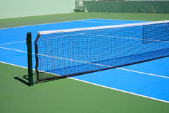 Blue and green tennis court Stock Images