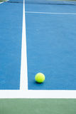 Blue and green tennis court surface,Tennis ball on the field Royalty Free Stock Images