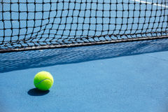 Blue and green tennis court surface,Tennis ball on the field Royalty Free Stock Photography