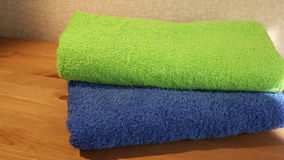 Blue and green towels stock video footage
