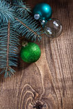 Blue green and transparent christmas balls withpinetree branch o Royalty Free Stock Image