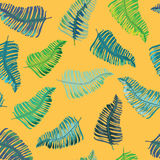Blue, green and turquoise tropical leaves seamless pattern. Vector illustration on orange background. Hand drawn tropical leaves seamless pattern on orange royalty free illustration