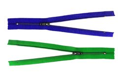Blue and green unzipped zips - isolated Royalty Free Stock Photo