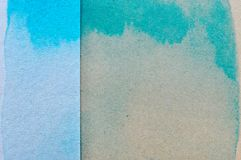 Blue and green watercolor on brown paper background.  royalty free stock photos