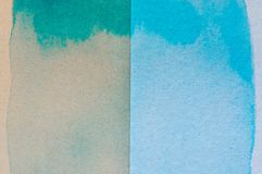 Blue and green watercolor on brown paper background.  stock photos