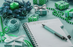 Blue and green wish list among presents Stock Photography
