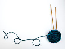 Blue-Green Yarn with Knitting Needles stock photography