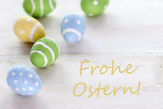Blue Green And Yellow Easter Eggs With German Text Frohe Ostern Means Happy Easter Royalty Free Stock Photo