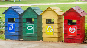 Blue, green, yellow and red bins. Stock Image