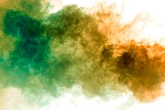Blue, green and yellow smoke swirls on a white background depicting a beautiful pattern, decorative ornaments. Color transition by. Substance molecules stock photo
