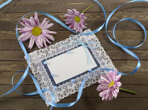 Blue greeting card with flowers Stock Photos