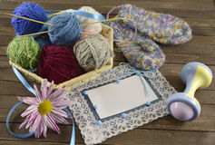Blue greeting card with knitting things Stock Image