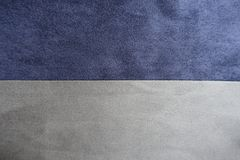 Blue and grey artificial suede sewn together horizontally. Blue and grey artificial suede fabric sewn together horizontally Royalty Free Stock Image