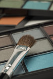 Blue, grey and brown eye shadow with a brush Royalty Free Stock Image