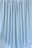 Blue grey curtain fabric Stock Image