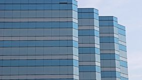 Blue and Grey Glass. Building against sky royalty free stock images