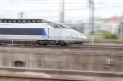 Blue and grey high-speed train royalty free stock photo