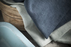 Blue and Grey Linen On Wooden Basket By a Tray royalty free stock photography