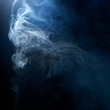 Blue/Grey Smoke on Black Background. Detailed, intricate texture background of blue grey hazy smoke Royalty Free Stock Photo