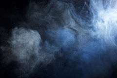 Blue/Grey Smoke on Black Background Royalty Free Stock Image