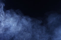 Blue/Grey Smoke on Black Background. Texture background of blue grey hazy smoke Royalty Free Stock Photography