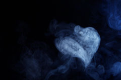 Blue/Grey Smoke in the shape of a heart on Black B Royalty Free Stock Photography