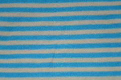 Blue and grey stripes. Made on fabric royalty free stock image
