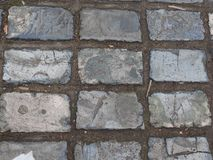 Blue-grey tiled pavement on a street in Rochester, Kent Royalty Free Stock Images