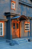 Blue grey wooden house facade in sunset Royalty Free Stock Image