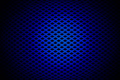 Blue Grille. Blue spot-lit speaker grille stock images