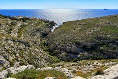 Blue Grotto bay, Mediterranean seacoast panorama, Malta. Limestone rocks and mediterranean seacoast at popular tourist attraction Blue Grotto on a sunny day Royalty Free Stock Image