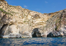 Blue Grotto coast. Limestone rocks with caves and clear turquoise water near popular tourist attraction Blue Grotto on a sunny day in September in Malta stock image
